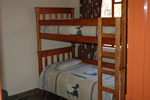 Double bunk bed in brick chalet